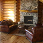 Interior natural log Living roomTop Mountain Homes Builder Colorado